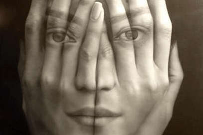 black and white photo. A woman's face is seen on top of (or through) a pair of hands