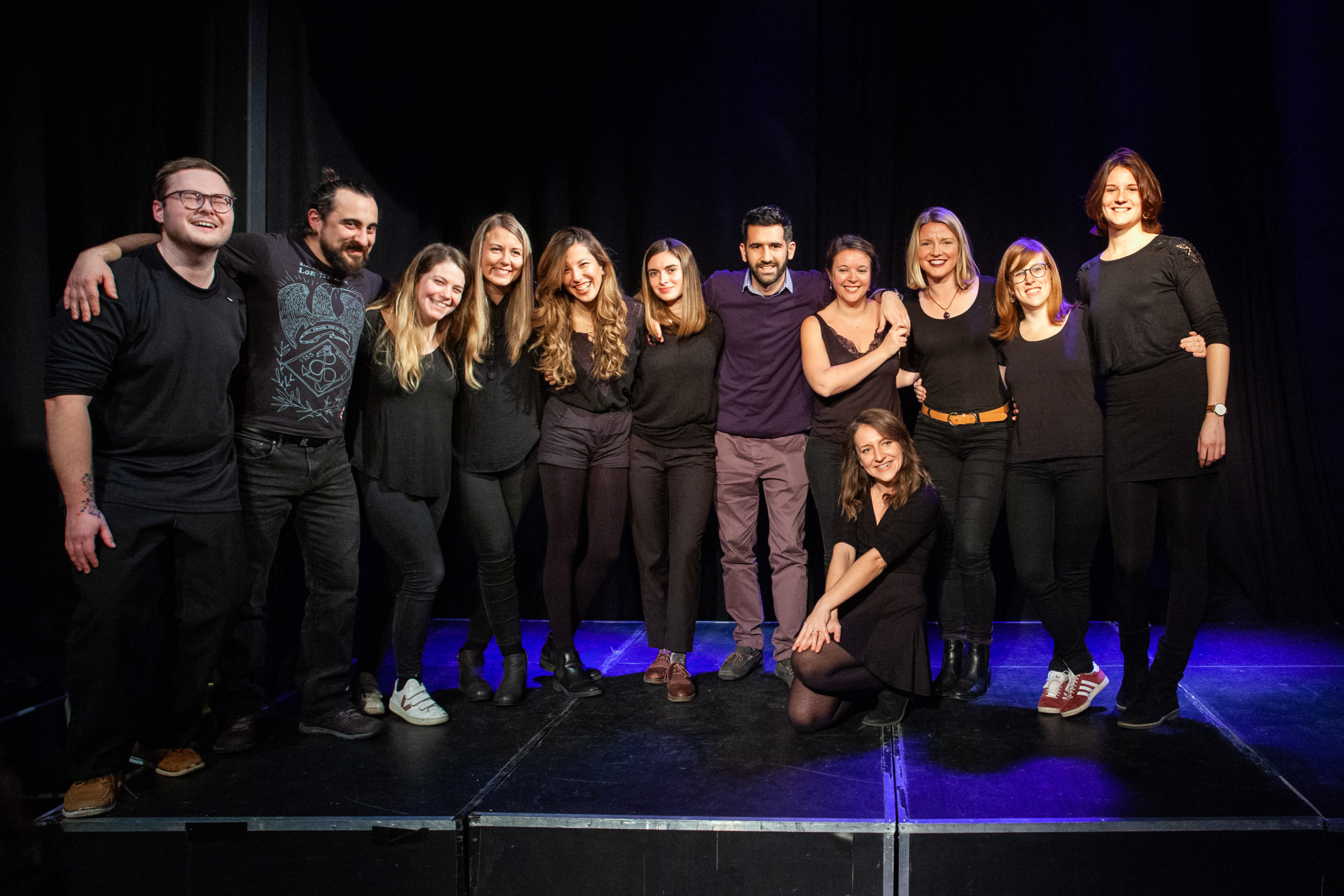 Act Attack's improv and physical show. A group of people on stage wearing black clothes. Group photo after the show